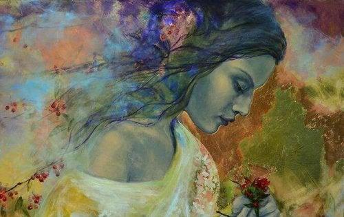Женщина с цветами в руке и эмоциональная губка
