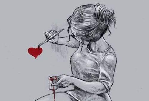 Женщина рисующая сердце и разочарование