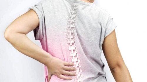 Сколиоз вызывает боль в спине